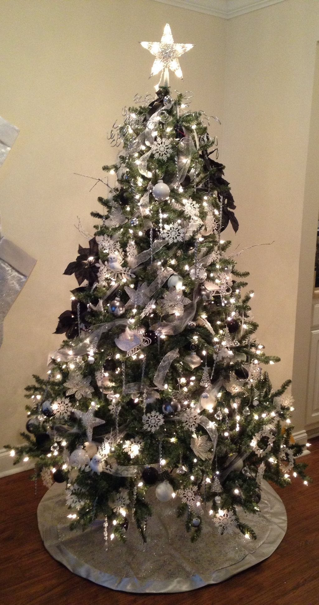 White christmas tree with silver and blue decorations