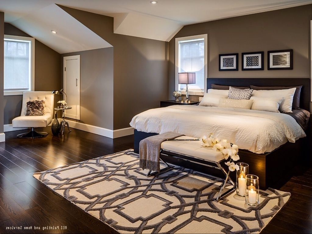 A Warm And Cozy Bedroom With Dark Hardwood Floors And