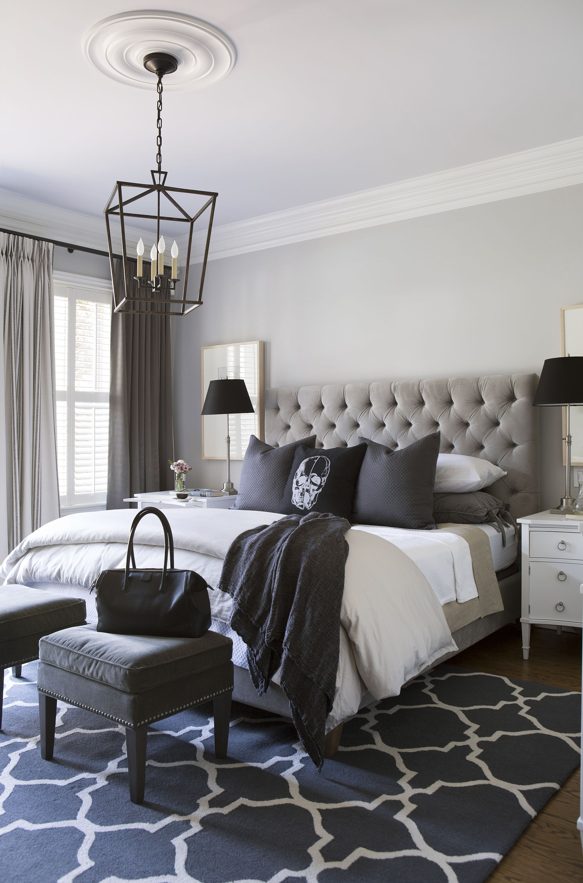 Master Bedroom In Greys And Lavender With Skull Cushion